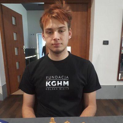 FM Kacper Grela